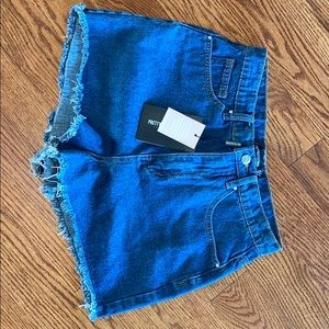 Mid wash Shelby high waisted denim shorts